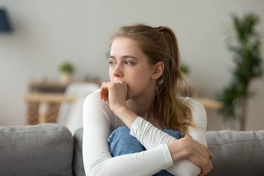 Girl biting hand showing anxiety